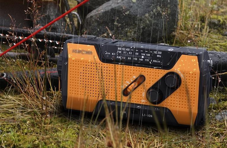 FosPower Emergency Solar Hand Crank Portable Radio with a flashlight.